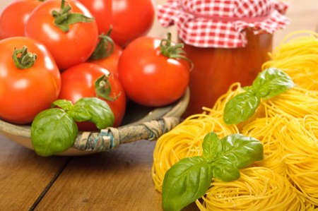 bolognaise: Tomatoes in a rustic bowl with pasta and bolognaise sauce  Stock Photo
