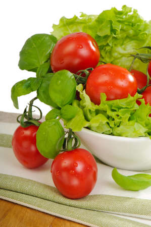 washed: Freshly washed tomatoes and lettuce for salad Stock Photo