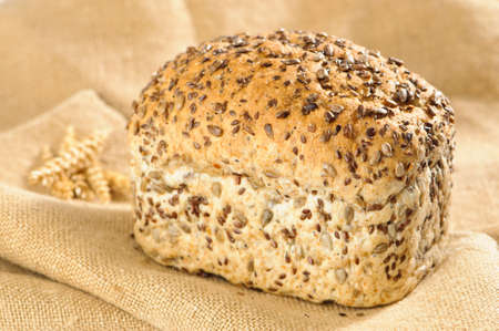unsliced: Fresh loaf of healthy sunflower seeded bread