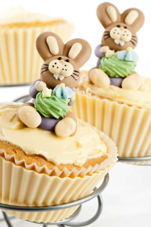 Easter bunny cupcakes on cake stand - white background photo