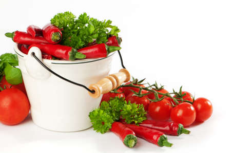 Red chili pepper and tomatoes with parsley and basil herbs Stock Photo - 5578347