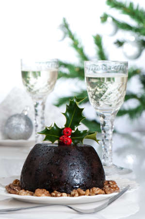 christmas pudding: Christmas pudding table setting, slight cool tone and blown out high key background