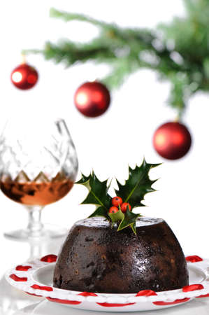 christmas dish: Christmas pudding at the table with brandy  Stock Photo