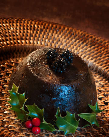 Christmas pudding with blackberries, gelled blur lighting