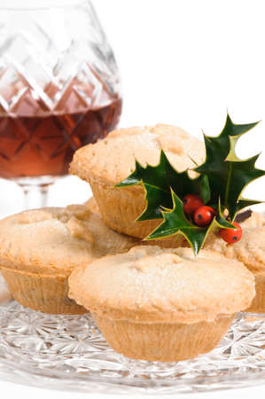 Christmas mince pies decorated with holly and berries with brandy Stock Photo - 5621652