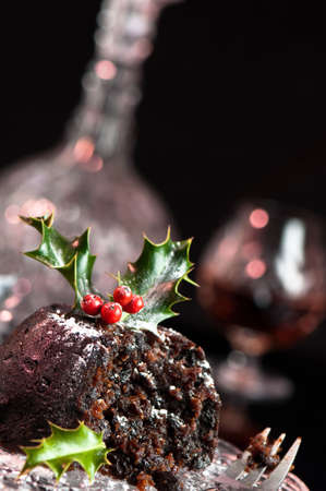 plum pudding: Christmas pudding with holly leaves and berries - angled view