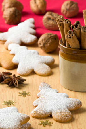 Christmas baking with gingerbread trees dusted with icing sugar photo