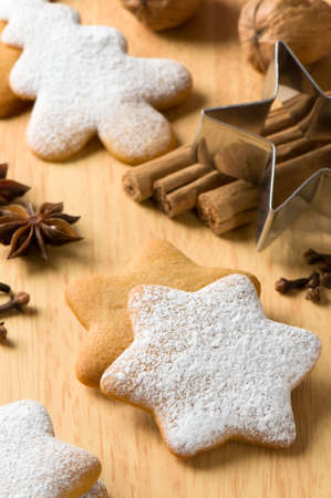 Baking at Christmas time with gingerbread stars and trees with metal star cutter photo