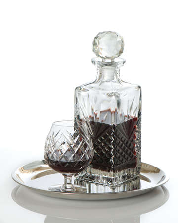 Decanter of rum with glass on silver serving tray - white background Stock Photo - 5670196
