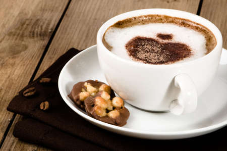frothy: Frothy cappuccino dusted with heart shape topping with florentine biscuits