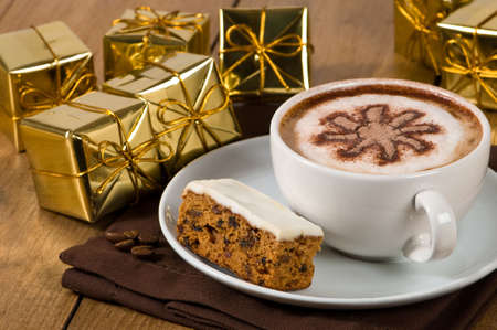 Christmas coffee break with a cappuccino and slice of cake photo
