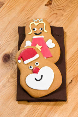 Home baked Christmas gingerbread fairy and Santa Claus photo