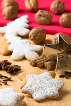 Baking at Christmas time with gingerbread biscuits and spices photo