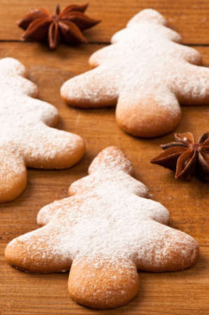 Christmas tree gingerbread cookies dusted with icing sugar photo