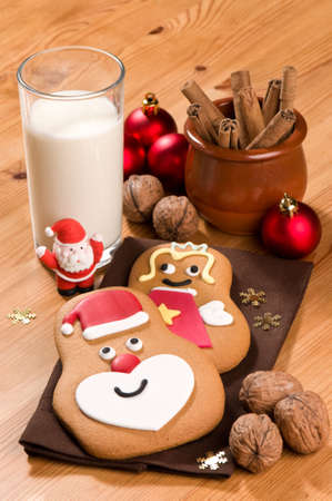 Gingerbread and glass of milk left out for Santa Claus on Christmas eve photo