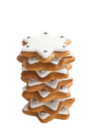 Christmas gingerbread star cookie stack isolated on white background photo