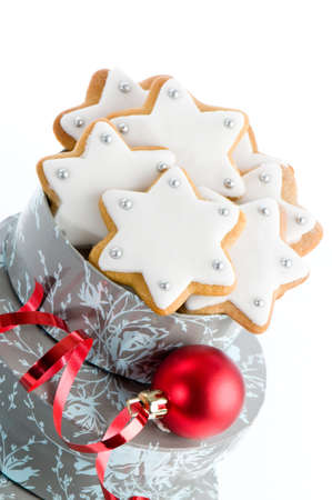 Home baked Christmas gingerbread stars as gift with red bauble and ribbon Stock Photo - 5767886