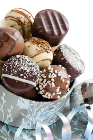 Close up of luxury Christmas chocolates with silver bauble and ribbon photo