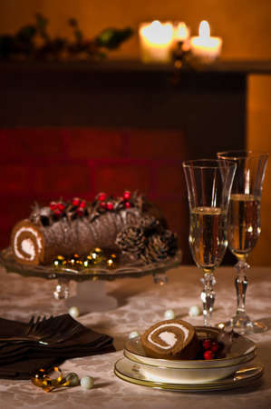 yule log: Christmas table setting with chocolate yule log