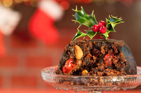 Close up of luxury Christmas pudding with festive background photo