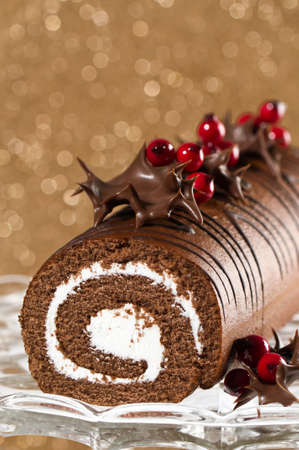 swiss roll: Christmas roulade decorated with chocolate dipped holly leaves