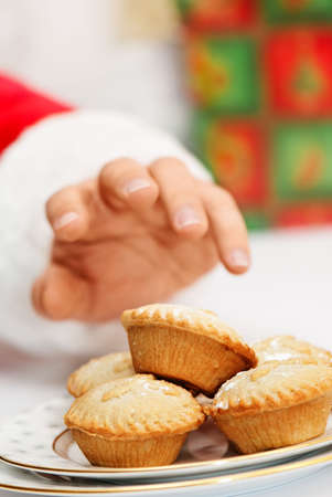 mince pie: Santa Claus on Christmas eve taking a mince pie