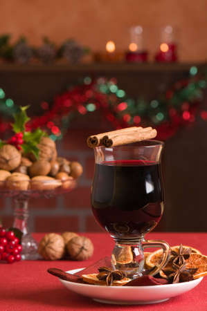 mulled wine: Mulled red wine at Christmas with selection of nuts in background