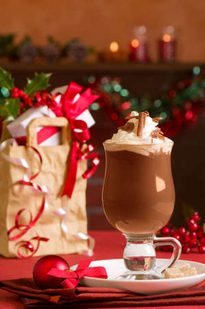 hot chocolate drink: Hot chocolate or Irish coffee at Christmas with presents in festive setting Stock Photo