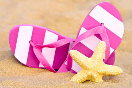 Summer flip flops on the beach with starfish photo