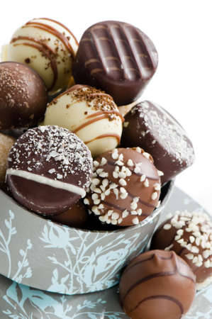 Close up of luxury chocolate selection on stack of boxes photo
