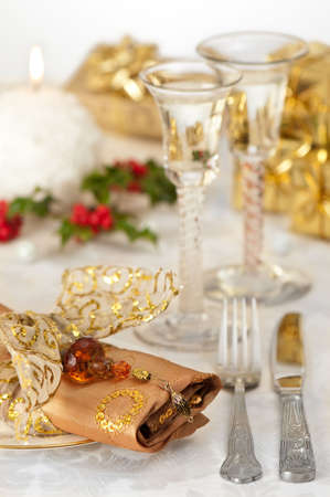 Festive Christmas table setting with gold and red theme and antique wine glasses, selective focus on napkin jewel Stock Photo - 5837070