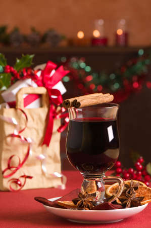 Christmas mulled wine with gift bag with presents in background photo