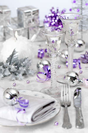 Christmas wine table setting with purple and silver theme, focus on the stem of antique glass  photo