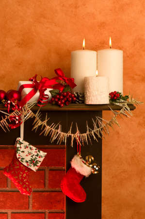 Decorated festive Christmas fireplace with lit candles photo
