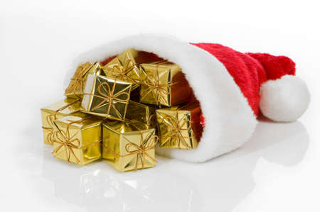bobble: Santa hat on white background filled with gold wrapped presents tied with little bows