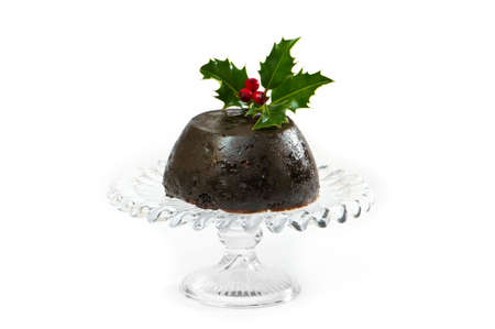 Christmas pudding with holly and berry decoration on white background photo