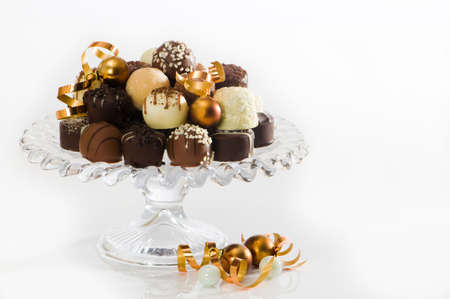 copper coated: Luxury Christmas chocolates with baubles on white background