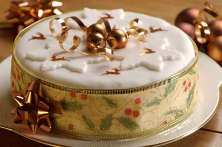 christmas cake: Festive Christmas cake decorated with gold baubles and reindeer confetti