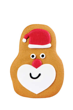 Gingerbread decorated as Santa Claus isolated on white background photo
