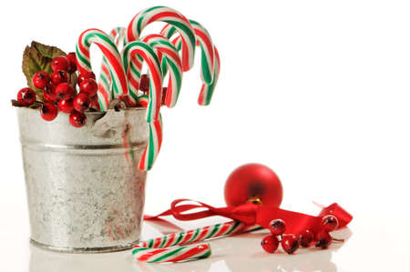 bucket of festive christmas candy canes with decorations on white background stock photo 6006641 - Christmas Candy Cane Decorations