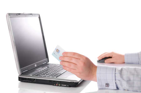 Shopping on the internet with credit card - white background with copy space photo