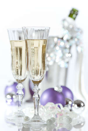 flute key: Glasses of champagne with ice bucket in background - high key effect, focus on front glass Stock Photo