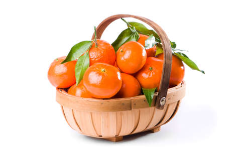 clementine fruit: Wooden trug filled with fresh ripe clementine fruit on white background Stock Photo