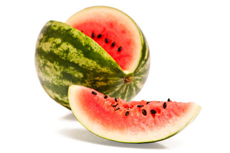 pips: Watermelon with cut slice revealing the flesh and pips inside