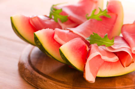 Melon and black forest ham prepared for appetizer photo