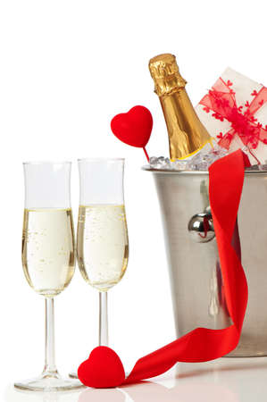 ice bucket: Glasses of champagne for Valentines day with heart and ribbon decoration Stock Photo