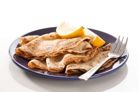 shrove tuesday: Freshly prepared pancakes for Shrove Tuesday with wedges of lemon