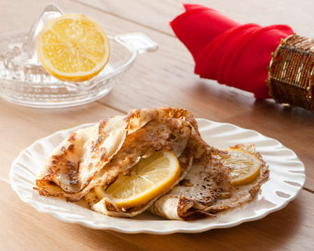 shrove tuesday: Pancakes for Shrove tuesday with lemon slices, napkin in background