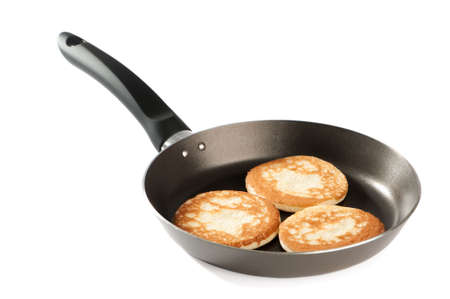 shrove tuesday: American style pancakes in frying pan on white background Stock Photo