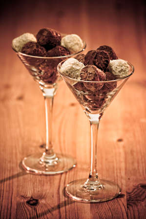 Luxury chocolate truffles in glasses on rustic wooden table Stock Photo - 6372753
